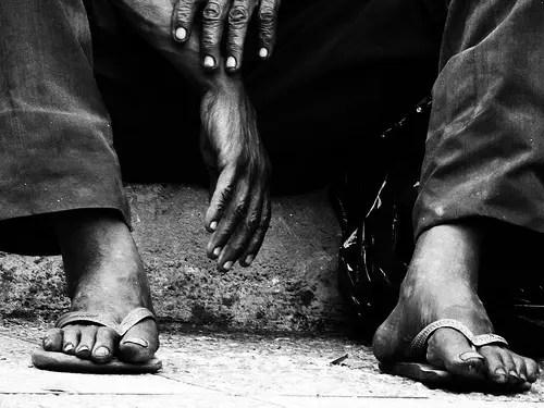 Slipper-clad feet of a Black man