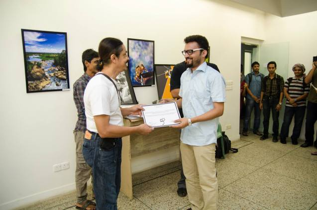 Receiving one of the best photo awards from honorable Photogapher Hasan Chandan Sir