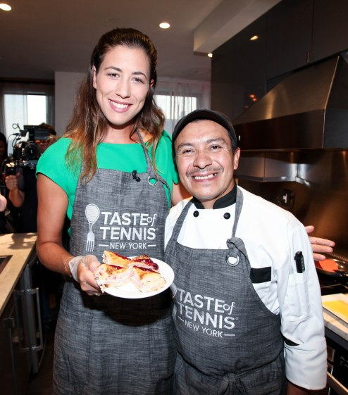 NEW YORK, NY - AUGUST 24: (L-R) Garbiñe Muguruza and Chef Arturo Vivanco cook together during The Taste Of Tennis Master Class With St Giles Hotels at The Tuscany, A St Giles Signature Hotel on August 24, 2016 in New York City. (Photo by Donald Bowers/Getty Images for St Giles Hotels)