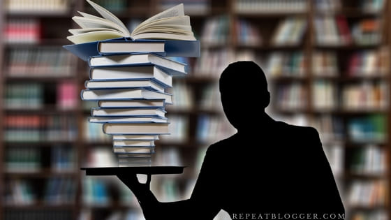 anonymous man serving stacked up books