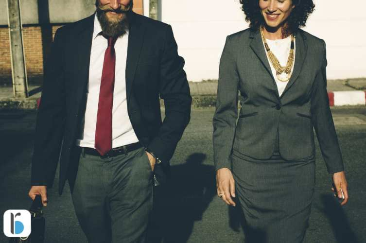 Keep a positive mindset creating a successful online business. Business man and woman smiling