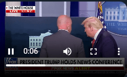 Trump was taken out of the room shortly after the press conference began.
