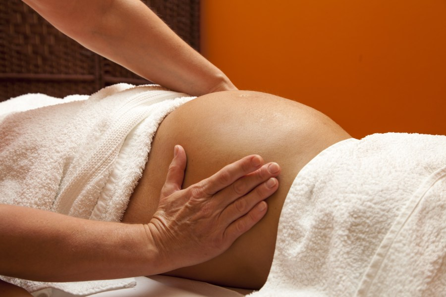 women giving a great massage with soft hands for a prenatal massage