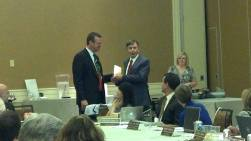 Outgoing board member Tom Crowe is recognized by Whitney Cunningham