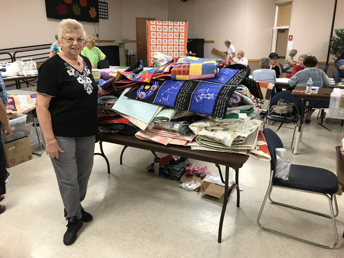 Carol Pettis and her 89 donated quilts