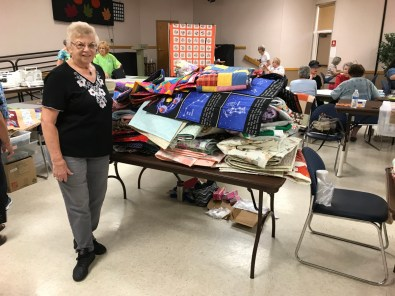 Carol P and her 89 donated quilts.
