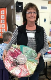 Janet T is double lucky at this bee! She wins the fabric raffle basket as well as the quilted wall hanging.