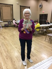 Returning AZB4K Board member, Sylvia S, takes the cash winnings from our 50/50 drawing. Welcome back, Sylvia!