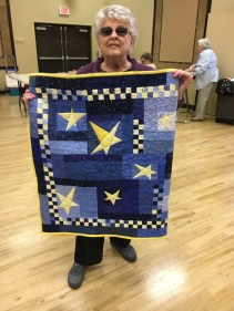 Marilyn T, from LaHacienda, wins the shining starry night quilt.
