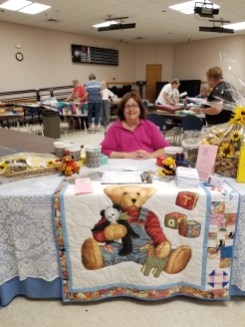 Nancy is organized and ready to welcome you to our bees and help you purchase lunch or raffle tickets.