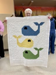 Miss Allie quilting up a whale of a tail, or three!