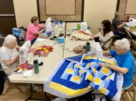 Piecing, free motion quilting, and binding. This table has a little bit of everything going on!