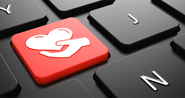 Heart in the Hand Icon - Red Button on Black Computer Keyboard.