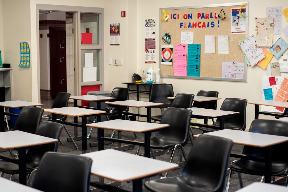 empty desks are shown in a classroom in scottsdale, arizona