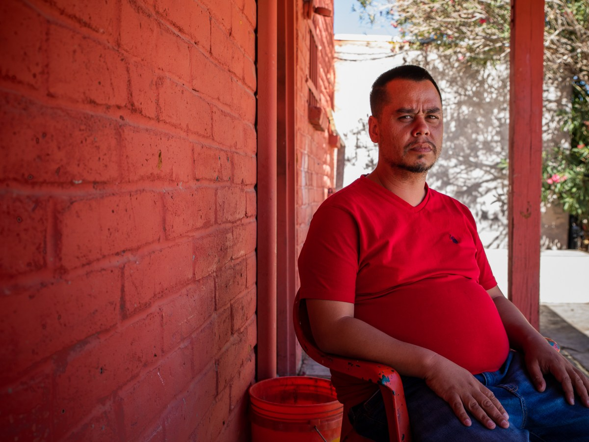 Aaron Wallace, 39, has been in Arizona's mental health system for 20 years. Shown here on May 25, 2021, Wallace sits outside a Tucson boarding house where he lived until June 2021. Photo by Alberto Mariani   AZCIR