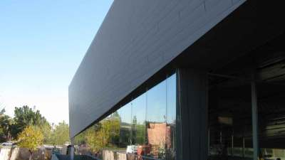 Arizona Science center early in the morning of the side profile of the sheeted side of the building
