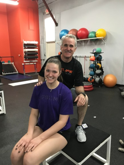 Female Volleyball Player with Athletic Trainer
