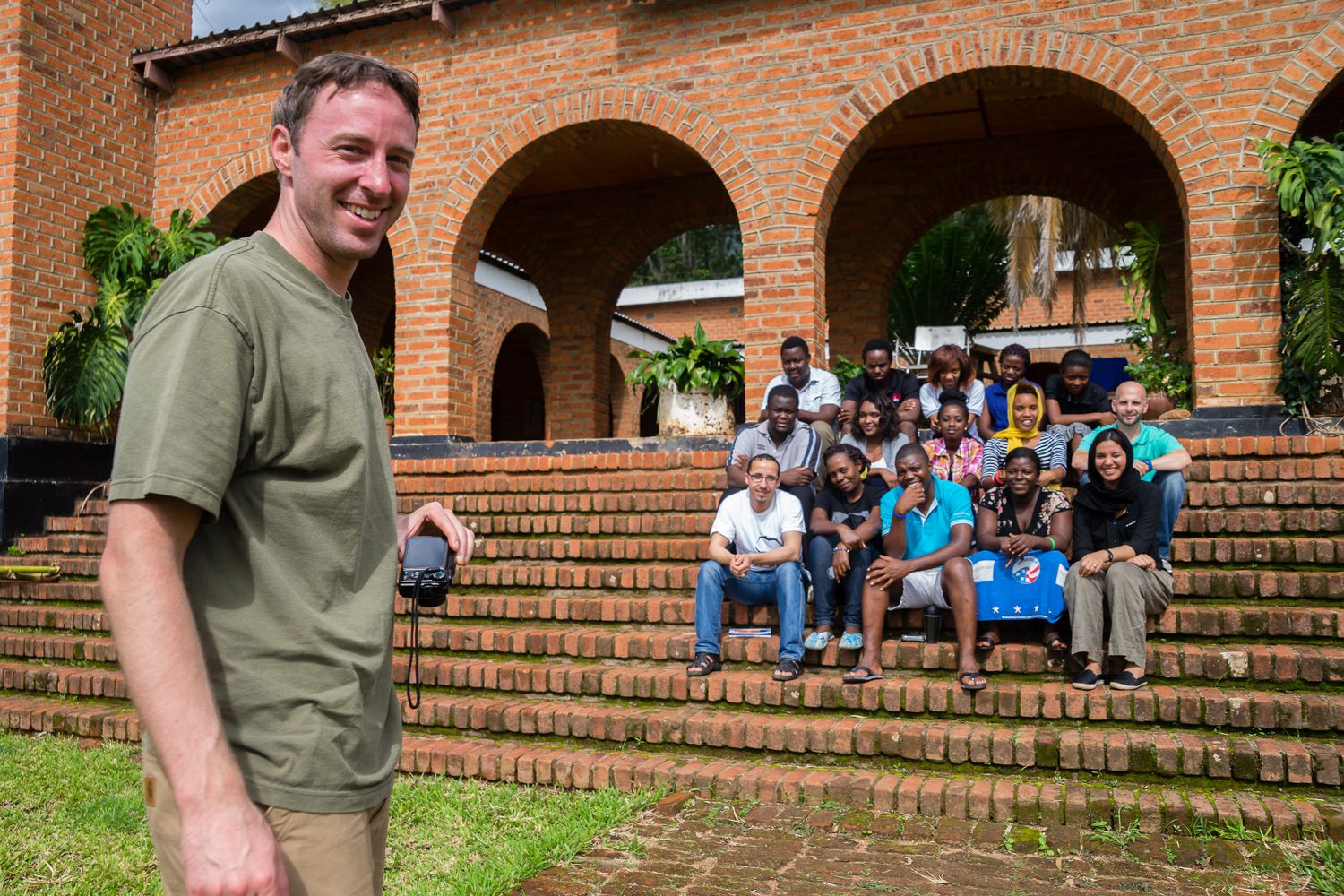 Garrett Mason with Corps Africa Malawi volunteers and stuff.