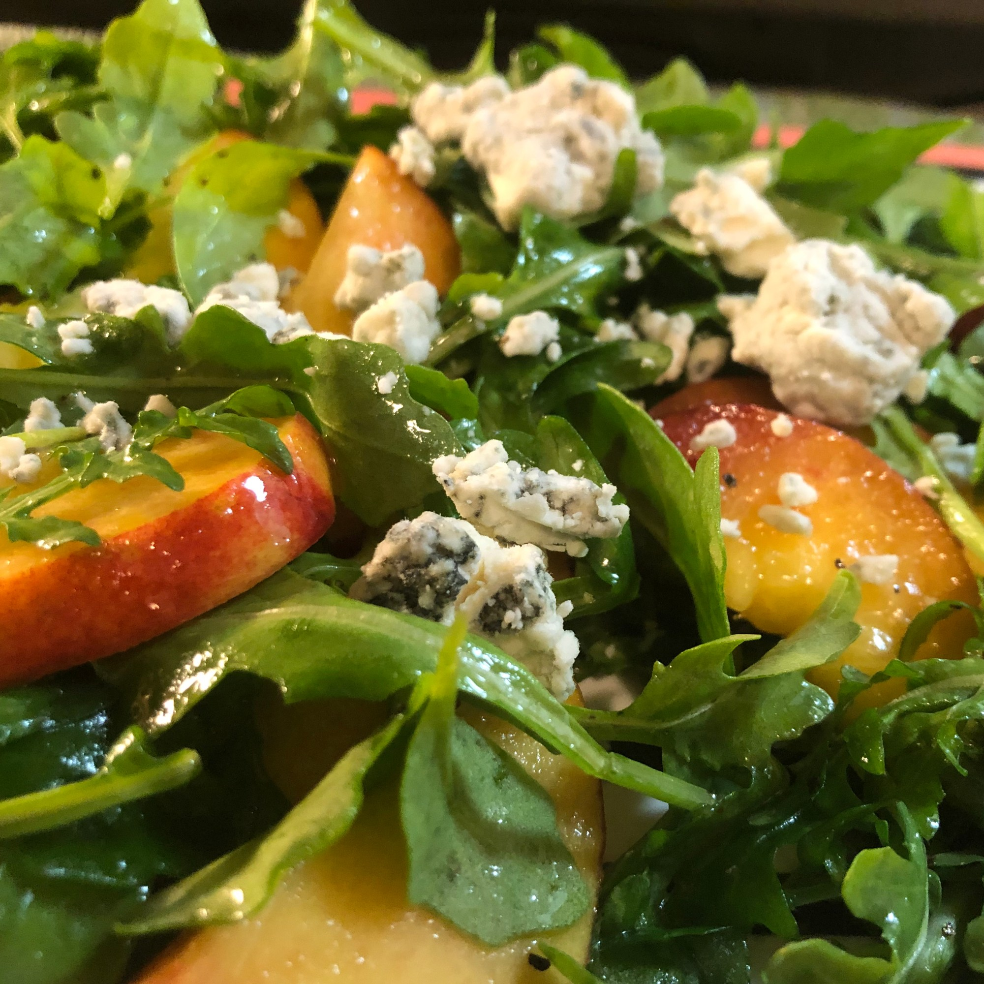 Nectarine and blue cheese arugula salad