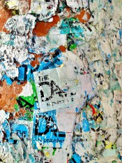 """Photo of stickers on a light pole outside the """"old Dali"""" building."""