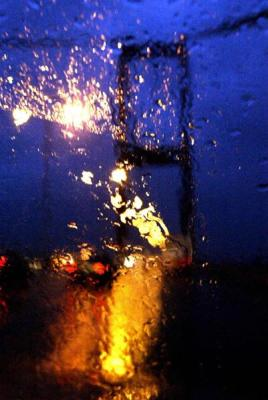 Bosphorus Bridge is seen under hard rain behind a car`s window which started lately today, downtown Istanbul, 24 October 2003, Friday. AFP PHOTO/ Mustafa Ozer
