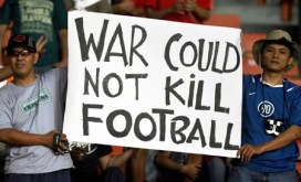 Indonesian football fans hold up a placard before the start of the Asian Football Cup 2007 final match between Iraq and Saudi Arabia at Bung Karno stadium in Jakarta, 29 July 2007. Meanwhile Iraq declared an overnight vehicle curfew in Baghdad and stepped up security as the country braced itself for celebrations and possible bomb attacks following the Asian Cup football final. AFP PHOTO/Bay ISMOYO (Photo credit should read BAY ISMOYO/AFP/Getty Images)