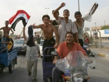 Residents celebrate the victory of Iraq's soccer team over South Korea during the semi-final of the 2007 AFC Asian Cup soccer tournament, in Kerbala, 110 km (68 miles) south of Baghdad, July 25, 2007. REUTERS/Mushtaq Muhammad (IRAQ)