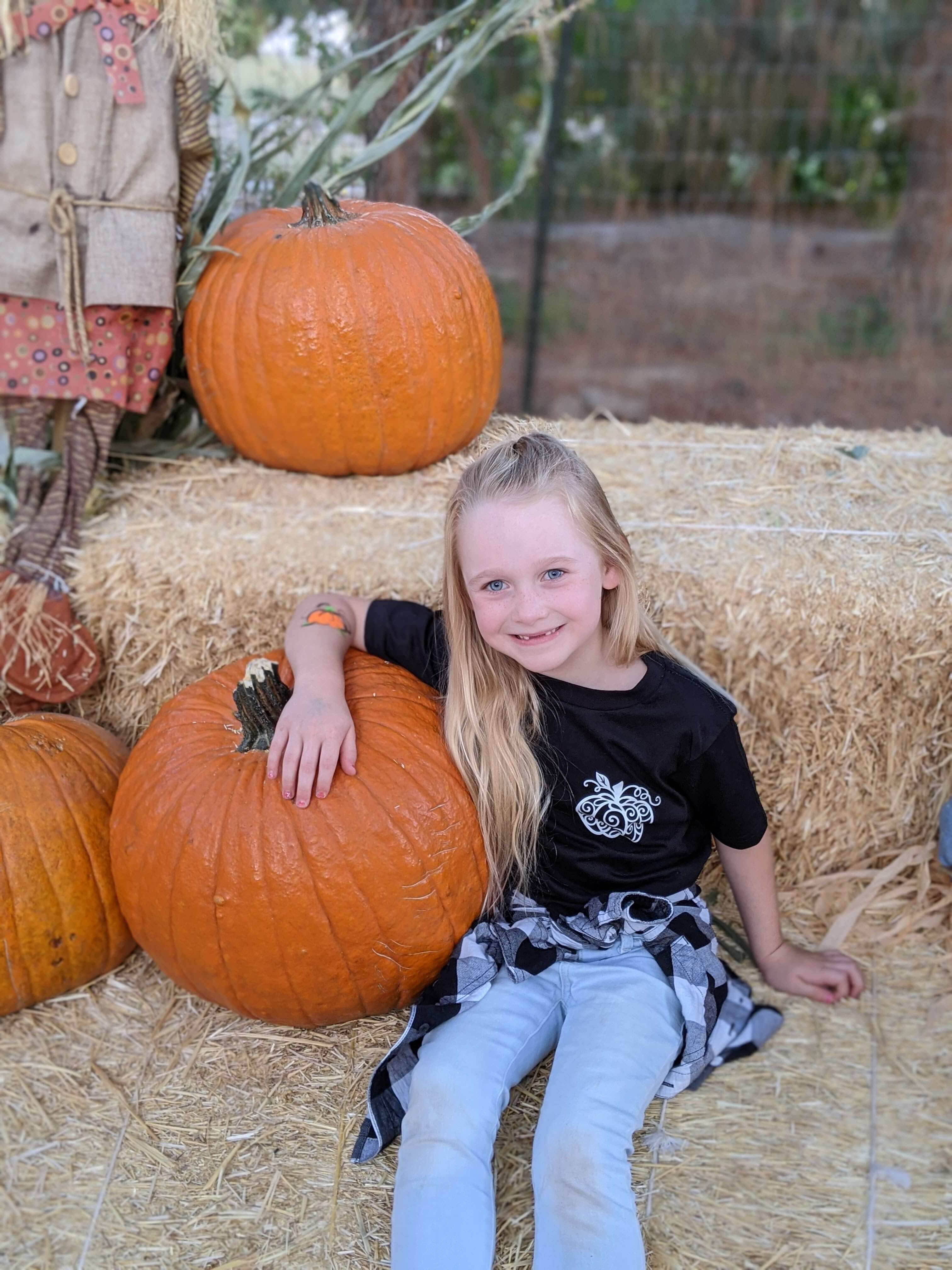 Schnepf Farms - Girl on hay bale