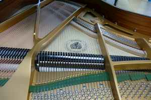 A cast iron harp inside a piano which can cause problems when you need to move a piano.