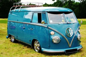 An older blue Volkswagen van.