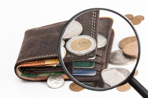 A look at a wallet through a magnifying glass.