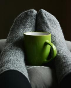 A coffee cup ona pillow
