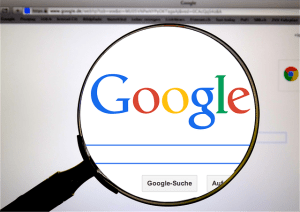 A view at the Google Search through a magnifying glass.