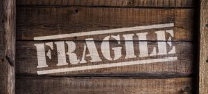 A packing box with a fragile sign you should pay close attention to after your move.