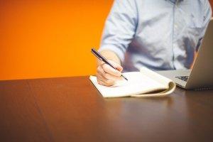 Man is writing.