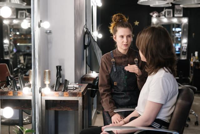 two women talking in a beauty salon in Nashville