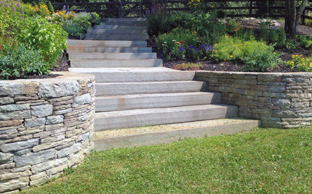 A curve natural stone retaining wall with blue stone, Stormville NY