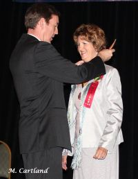 Patricia Little-Upah receives her AVHOF Medallion from Secretary of State Ken Bennett