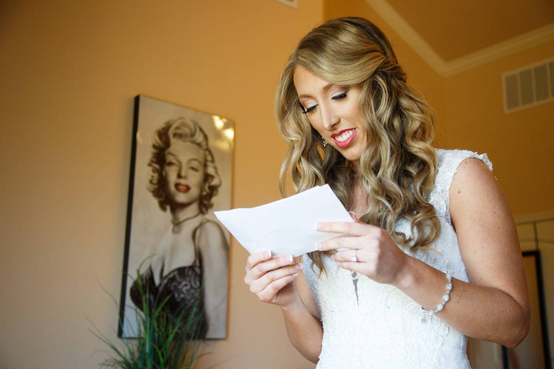 Antebellum Oaks Wedding - Austin Wedding Photographer - Jacob and Katie - hill country wedding - reading note before ceremony - bridal party getting ready