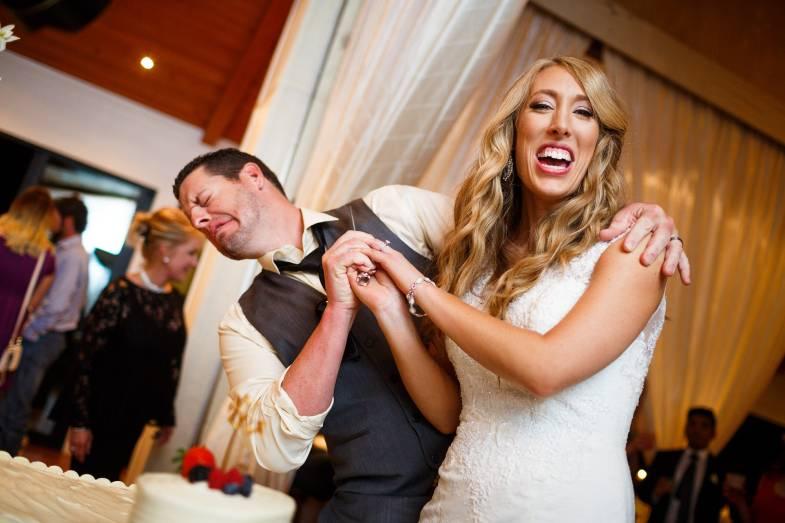 Antebellum Oaks Wedding - Austin Wedding Photographer - Jacob and Katie - hill country wedding - wedding reception - wedding cake - bride and groom cutting wedding cake - funny moments -