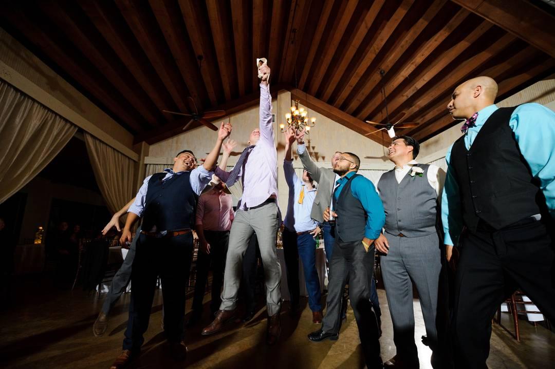 Antebellum Oaks Wedding - Austin Wedding Photographer - Jacob and Katie - wedding reception - groomsman having fun