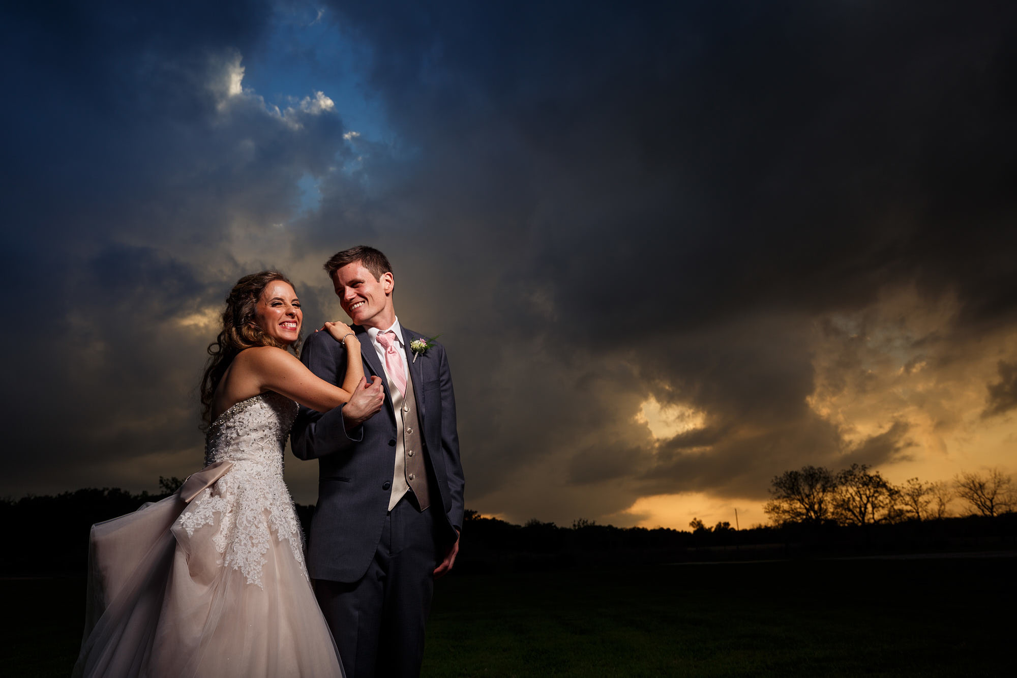 Austin Wedding Photographer - Dramatic storm cloud sunset with bride and groom.