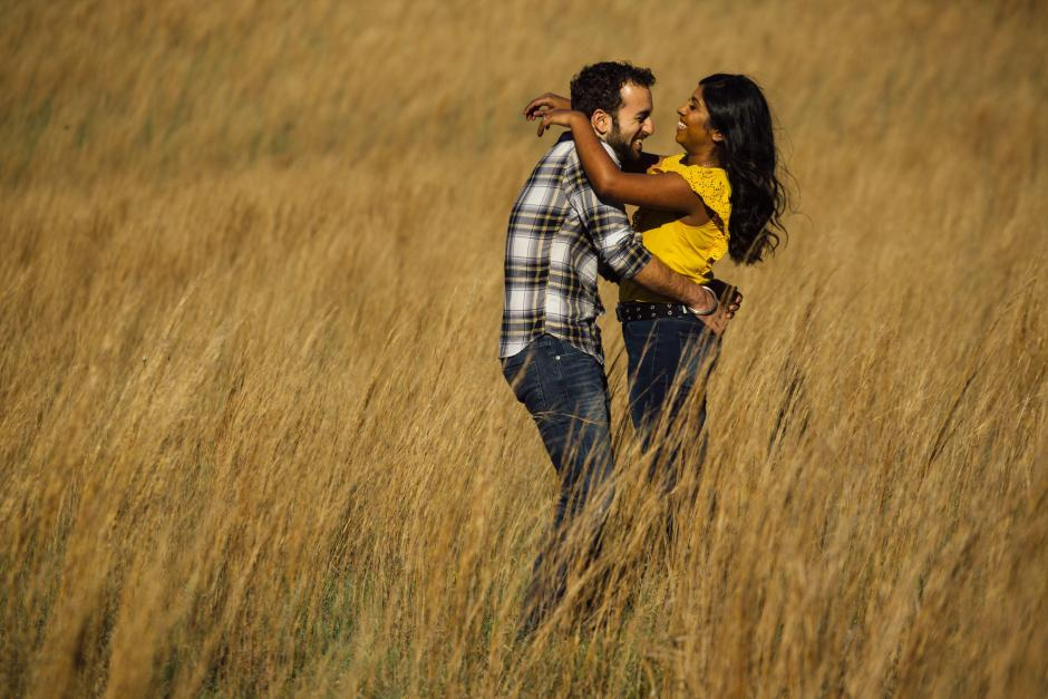 Austin Engagement Photos at Enchanged Rock - Couple in a Field of Tall Grass