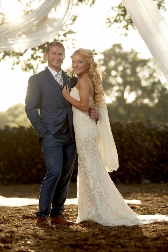 Golden hour wedding portraits of beautiful couple.