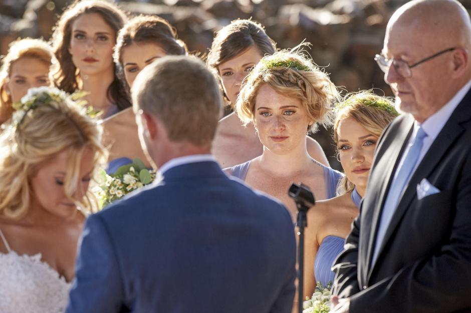 Claire's sisters, Alicia and Katie look on during the wedding ceremony.