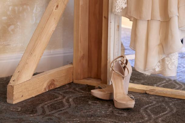 Brides shoes next to the under construction door.
