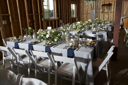 Reception tables in the barn.