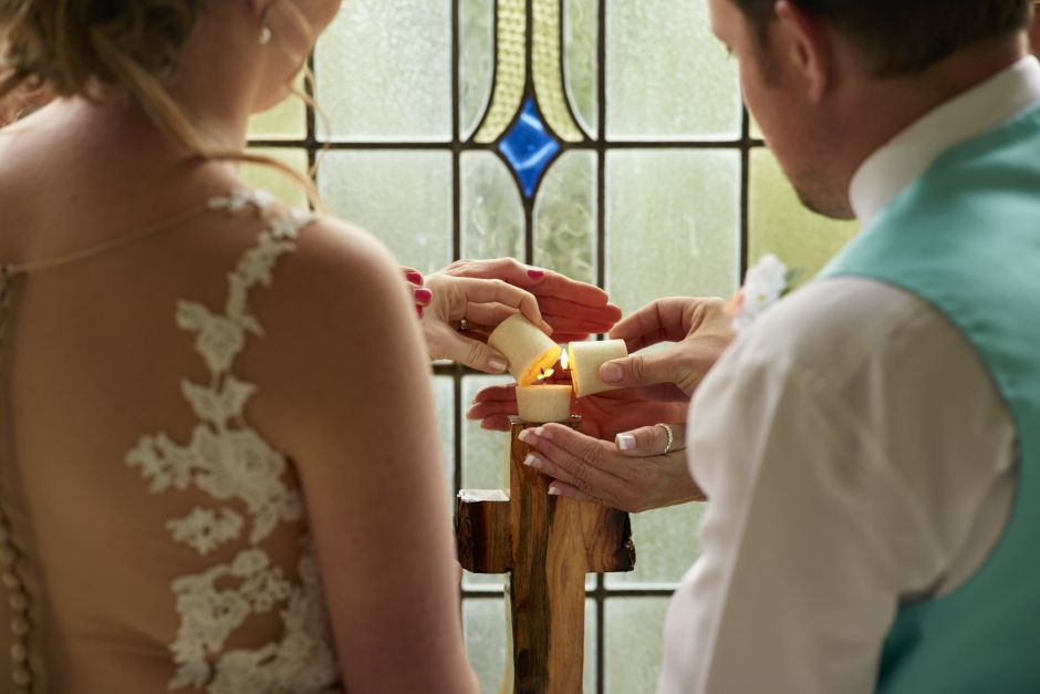 Bride and groom light unity candle at Gruene Estate in New Braunfels.
