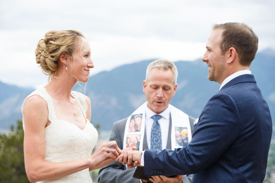 Allison give Gave a ring during their DIY Colorado Destination Wedding Ceremony