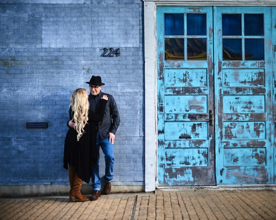 Downtown Georgetown Engagement photo against cool metal wall at Union on 8th